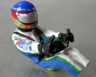 Painted figurine of Sébastien Loeb in 1/32nd scale